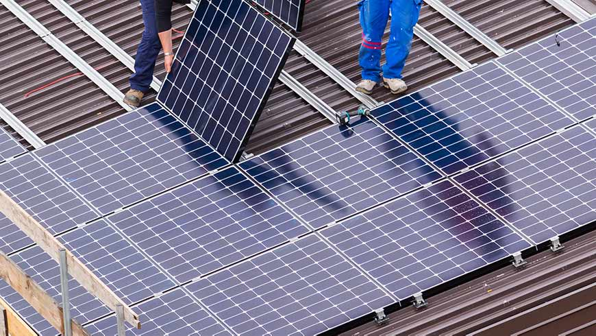 building infrastructure zero emissions Solar Panel and Workers - optimised